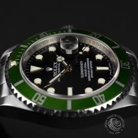 RO21193S Rolex Submariner Date Green Bezel Anniversary Close8